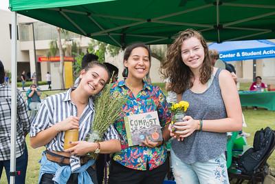 Jennifer Arredondo (left) Melissa Zamora, and Wren Woodburn promote the Islander Green Team initiatives during the Islander Dining's Farmer's Market on East Lawn.