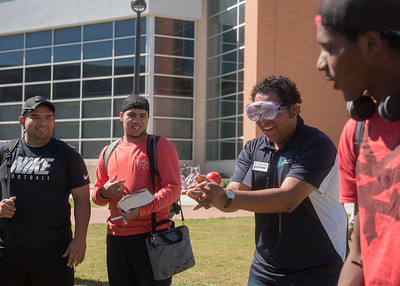 Student Antonio Sanchez tries to catch a ball while wearing drunk goggles during I-ADAPT'S Octoberfest.