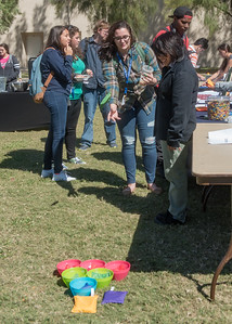 Student Bridgette Baldwin attempts to land a bean bag in a dish at Islander Cultural Alliance's table during I-Adapt's Octoberfest held on the East Lawn.