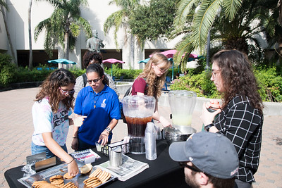 Students select from refreshments and cookies following a Drug Bust Demonstration on campus, in Hector P. Garcia Plaza.