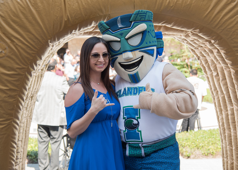 Amris Chacon rocks a shaka with Izzy the Islander during the 2017 Fall Ring Ceremony.