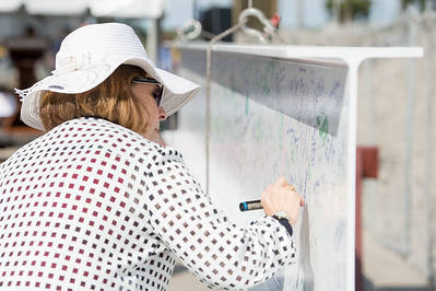 Dean of Graduate Studies, Dr. JoAnn Canales, writes her name on the steel beam later placed during the Topping Out Ceremony for Tidal Hall. Tuesday November 7, 2017 during the beam signing ceremony at TAMU-CC.