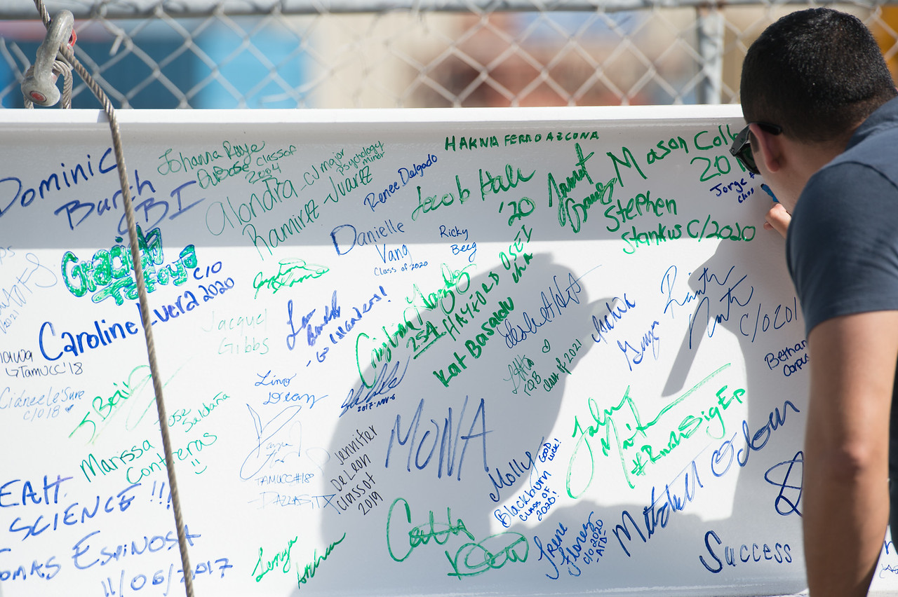 Jorge Fonseca his name on the steel beam later placed during the Topping Out Ceremony for Tidal Hall. Tuesday November 7, 2017 during the beam signing ceremony at TAMU-CC.