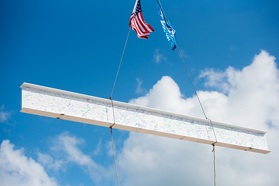 A steel beam signed by faculty, staff, and students is raised to the top floor of the Tidal Hall building. Tuesday November 7,2017.