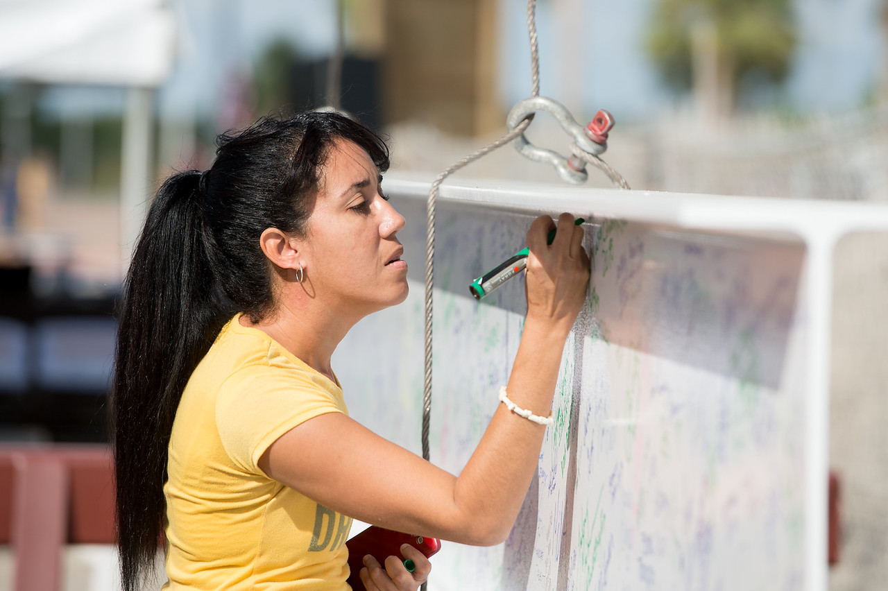 Hakna Ferro writes her name on the steel beam later placed during the Topping Out Ceremony for Tidal Hall. Tuesday November 7, 2017 during the beam signing ceremony at TAMU-CC.