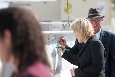 TAMU-CC President Kelly Quintanilla signs her name on the beam to be installed during the Topping Out Ceremony. Tuesday November 7, 2017 at TAMU-CC