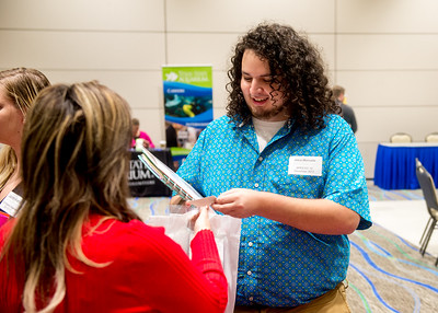 Student Jesus Moncada discusses about job opportunity at the Education Career Fair.