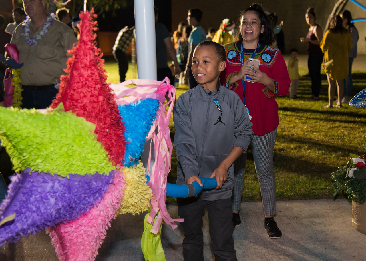 Christopher Prince (9) hits a pinata during the Islander Lights Celebration.