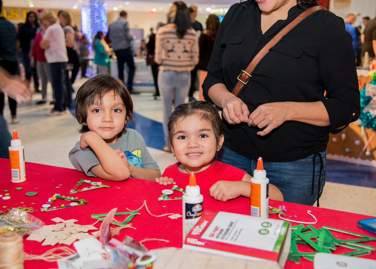 Jacob Riley Ramos (5) and Abigil Rose Ramos (3) make ornaments during the Islander Lights Celebration.