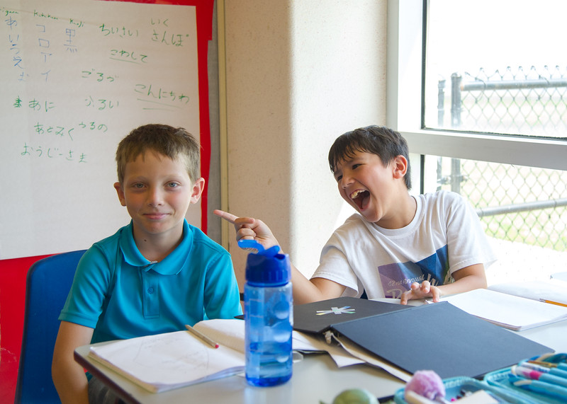 Mathew Reese and his friend during writing class in summer camp 2017.