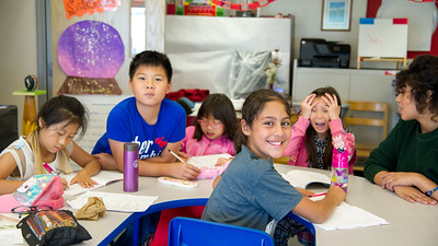 Kylie Escochea is working on her writings during the Summer Writing Camp with the other elementary kids.
