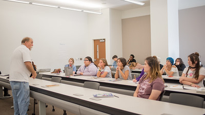 Dr. Ethridge gives a lecture to a group of highschool students about publishing during the Summer Writing Camp.