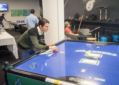 Diego Vado plays air hockey in the Breakers Game Room