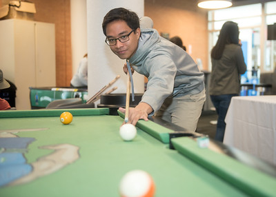 Jaizen Rabanzo plays a game of pool during the Breakers Gameroom Welcome Back Celebration.
