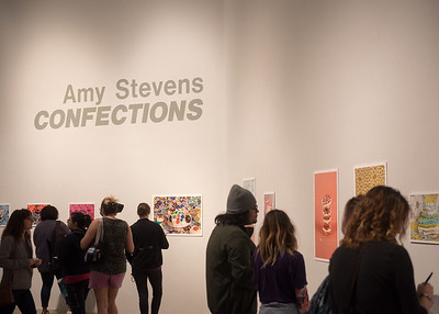 "Students checking out the ""Confections"" exhibit by Amy Stevens on display in the Weil Gallery."