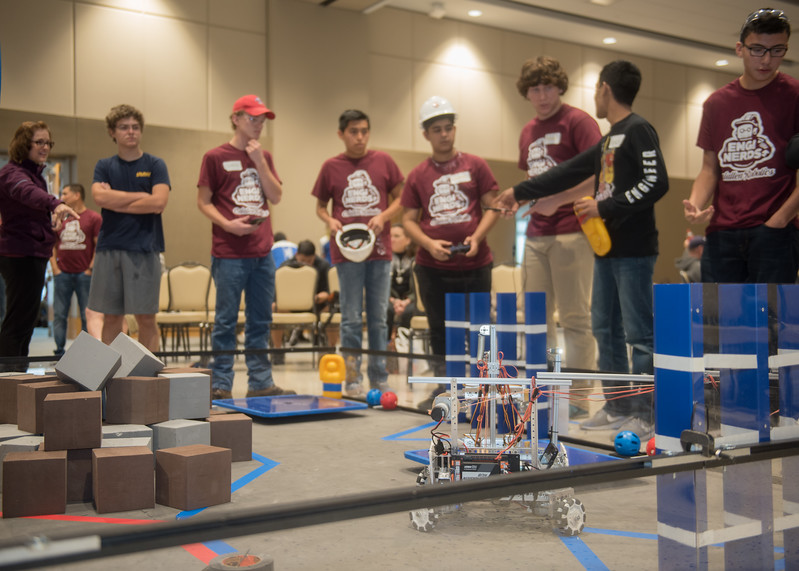 "The ""Enginerds"" team goes over last minute details in execution before the FIRST Tech Challenge competition."