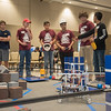 """The """"Enginerds"""" team goes over last minute details in execution before the FIRST Tech Challenge competition."""