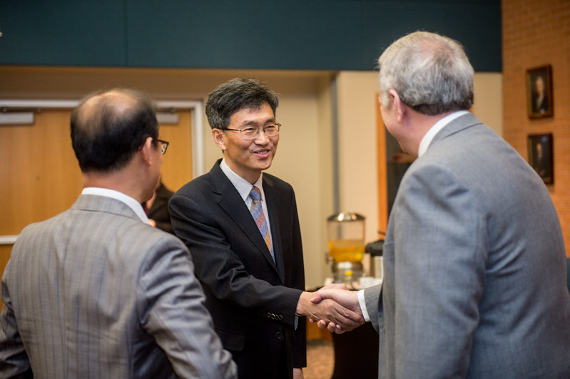 SASA Principal Dr. HeonSoo Kim (left), is greeted by Dr. David Bridges during the Sejong MOU Signing in the University Center's Legacy Hall.