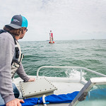 TAMU-CC Conrad Blucher Institute research engineer Alistair Lord prepares to hand off a module to Zachary Hasdorff during their CCPORTS installation off of the coast of Port Aransas, Tx.