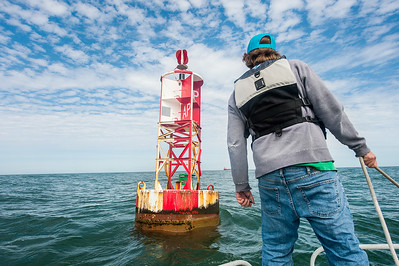 TAMU-CC Conrad Blucher Institute research engineer Alistair Lord prepares to board a buoy during a CCPORTS module installation off of the coast of Port Aransas, Tx.