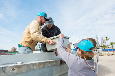 Conrad Blucher Institute researchers from Texas A&M University - Corpus Christi, load equipment on to their boat at the Port Aransas, Tx marina.