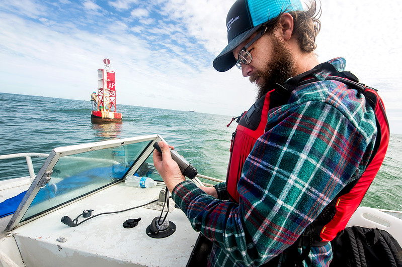 TAMU-CC Conrad Blucher Institute research engineer Hugo Mahlke reads GPS data during their CCPORTS installation off of the coast of Port Aransas, Tx.