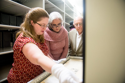 Erica Williams (left), shows Cecilia & Jim Akers an item from the Dr. Hector P. Garcia archive collection in the Mary and Jeff Bell Library's Collections and Archive department.