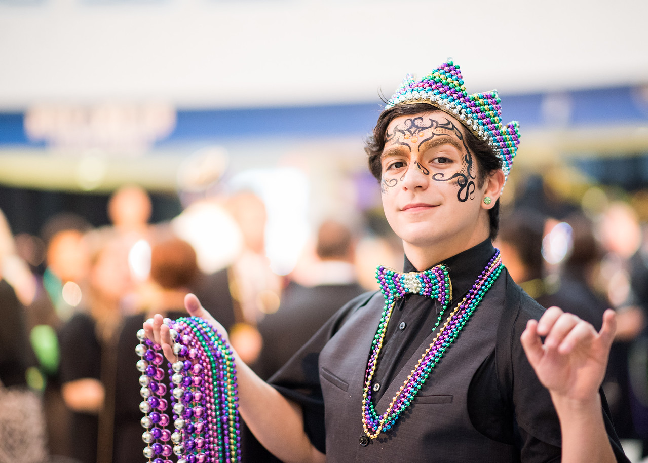 Christopher Niesner hands out Mardi Gras beads to guests during President's Ball on March 3rd, 2018 at Texas A&M University - Corpus Christi.