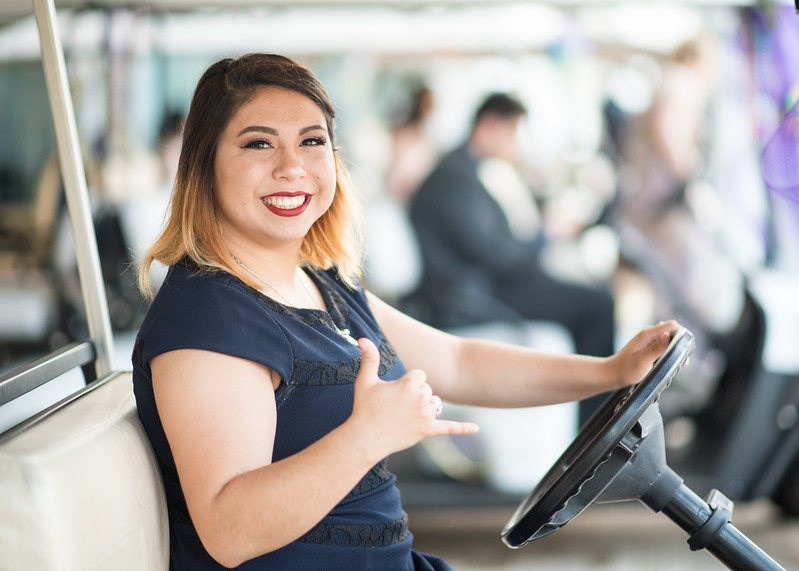 Student Caryn Garcia prepares to drive guests around the University Center during President's Ball on March 3rd, 2018 at Texas A&M University - Corpus Christi.