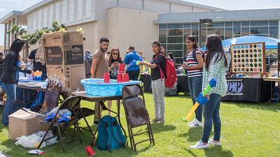 Mounica Gulllapalli tries to knock over towers of cups with a water gun during CAB's Wild & Wacky Wednesday.