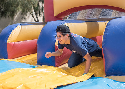 Daniel Hernandez finishes the inflatable obstacle course set up during CAB's Wild & Wacky Wednesday.
