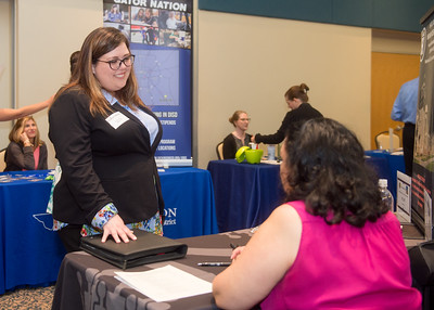 Islander student Savannah Olkowski talks to recruiters during the Careers in Education Fair.