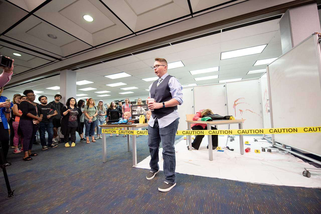 Dr. Wendi Pollock, associate professor of criminal justice, talks to Texas A&M University-Corpus Christi students during a live crime scene demonstration.