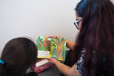 "Kimberly Cantu reads Red Rocket Readers ""rabbit's Ears"" with student Sophia Gallardo"