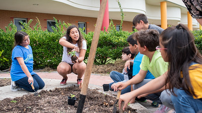 Melissa Zamora explaines to students of the ECDC on how to plant a plant.