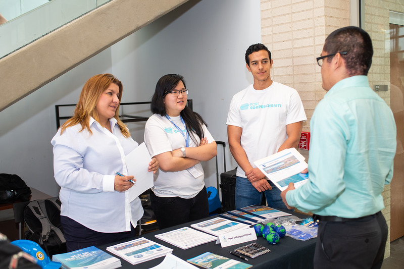 Port of Corpus Christi's Carol Rodriguez (left), Chi Quach, and Nicolas Arenas speak with ALejandro Agustin on job and internship opportunities. Thursday April 26, 2018 at the College of Business Career Fair in the O'Connor Building.