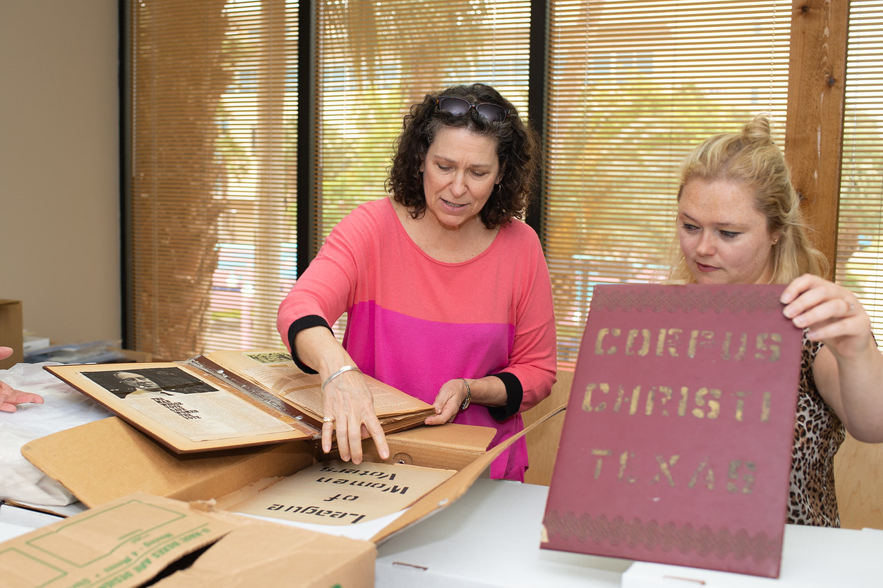Treasurer of the League of Women Voters - Corpus Christi, Brenda Hamby (left), and Alston Cobourn look through archival items from the LWV-CC in the Mary and Jeff Bell Library Archives and C ...