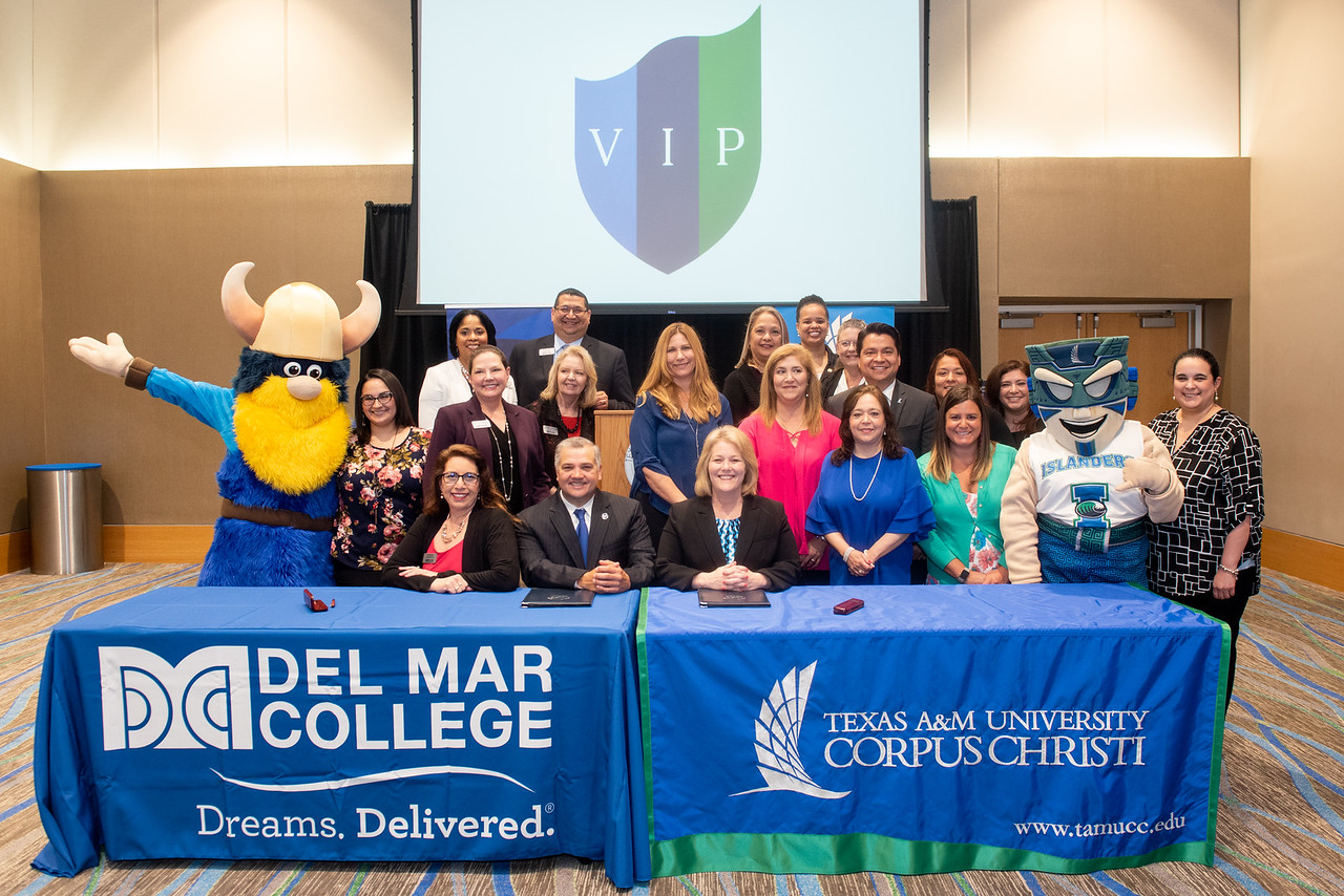 Texas A&M University-Corpus Christi and Del Mar College staff gather for a photo to commemorate the signing of the MOA agreement.   Click the link to read more about this event: http://bit.l ...
