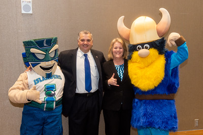 Izzy the Islander (left), Dr. Kelly M. Quintanilla, president and CEO of Texas A&M University-Corpus Christi, Dr. Mark Escamilla, Del Mar College president, and Valdar the Viking.