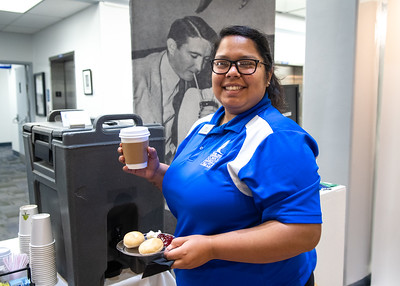 Alyssa Vasquez picks up coffee and bagels at the Mary and Jeff Bell Library
