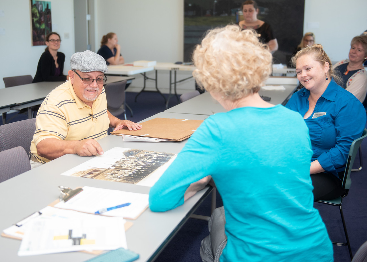 Corpus Christi resident Alfonso Gomez donates historical photos to be archived by the staff of the Mary and Jeff Bell Library during the Public History Harvest held at the Art Museum of Sout ...