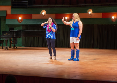 Alumna Erin Longoria (left) teaches incoming student Kennedy Bontrager and audience members about the shaka during Islander Launch.  There is still time to register for Islander Launch! Registration closes 2 weeks before each event date, so reserve your seat today: http://bit.ly/2tn45Uv