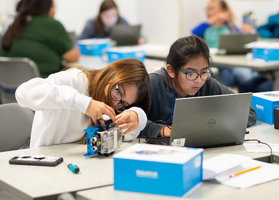 Sophia Massah (left) assembles an mBot while Erin Gallegos works on code during the Girls Code Camp.  Check out other summer camps available for kids and teens: http://bit.ly/2MighNt