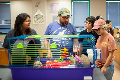 Lab Coordinator Philip Jose (center) introduces students Beatriz Garduno (left), Daisy Fuentes, and Destiny Rios to Prairie Dogs named Bonnie and Clyde, during their last day of the Summer 1 semester.