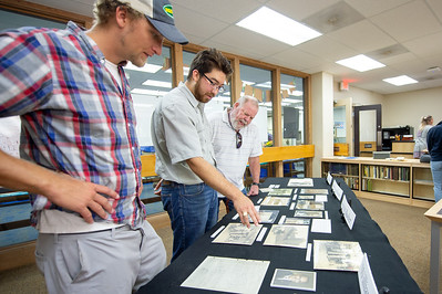 Kevin Wilson (left), Daniel Martinez, and Ed Saulter look through the Blucher Family Collection archived items at the Mary and Jeff Bell Library.