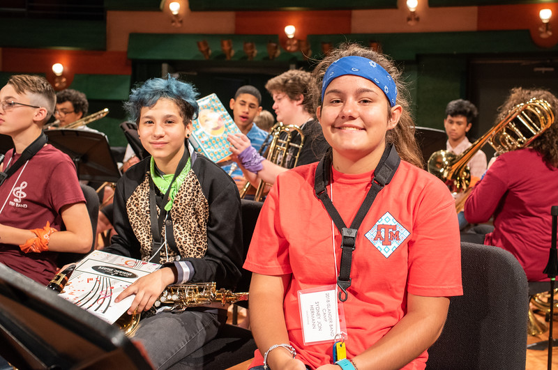 Morgan Pool (right) and Sydney Hermann pose for a photo during the Islander Band Camp's rehearsal held in the Performing Arts Center.