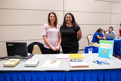 Kara Borland (left) and Cassandra Casanara great guests to the open enrollment & benefits fair in the University Center Anchor Ballrooms.