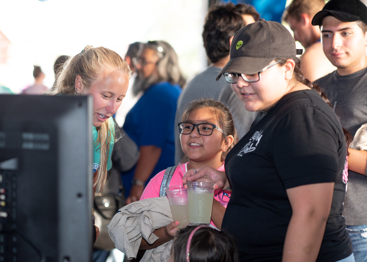 Melanie Dominguez (right) and Jaylean Dominguez, age 8, look up sharks on the Ocearch Shark Tracker during Shark Week Live at the Brewster Street Ice House.