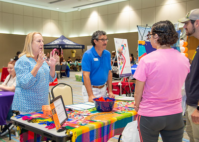 Susan (left) and Rene Trevino explain to students the types of tours they offer at Enjoy Corpus Christi Tours, LLC during the Cor[us Christi Community Fair.