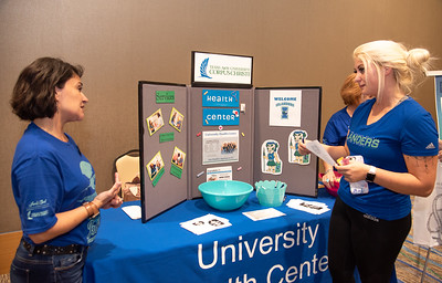 Raina Walls (right) receives information about the Universitys Health Center from Shelly Martinez-Lopez at the UC's anchor ballroom as a part of Islanders Night Out.